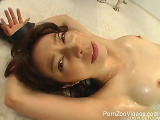 Extremely passionate Asian zoophile sucks a meaty dog dick
